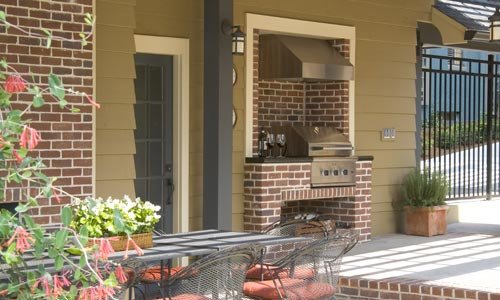 Patio with fireplace and cooktop stove