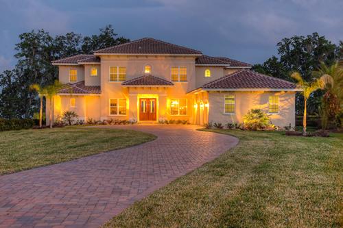 New custom home design with brick driveway