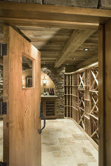 The 2 inch thick wine cellar door is constructed from the wood barn beams, which also appear on the ceiling in their rustic form.