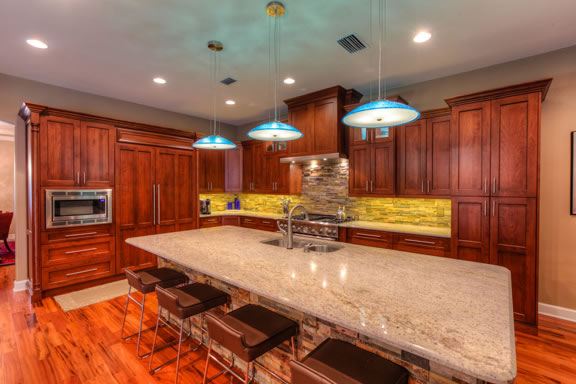 """The kitchen is outfitted with a concealed refrigerator, 48"""" Thermador range, and under-cabinet task lighting."""