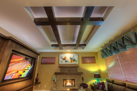 The raised ceiling is accented with maple beams and up-lighting.