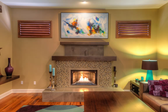 The linear gas fireplace is accented with a glass tile front.