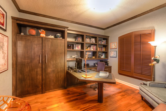 A non-functional closet was reconfigured into a storage/built-in bookcase unit constructed of maple, matching the custom-made contemporary desk.