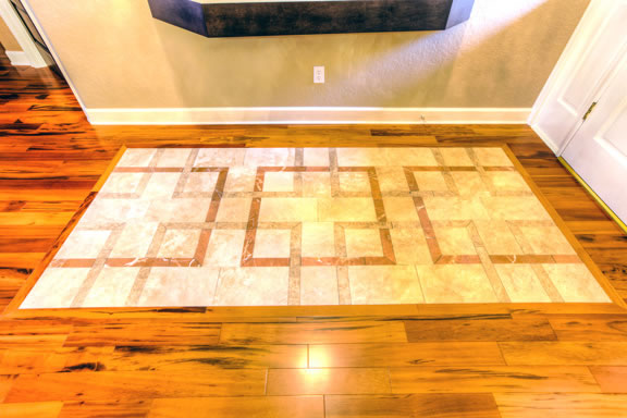 Making a welcoming first impression, the open foyer was refreshed with a travertine and marble inlay floor.