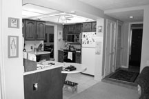 The kitchen before was outdated and closed off from important living space.