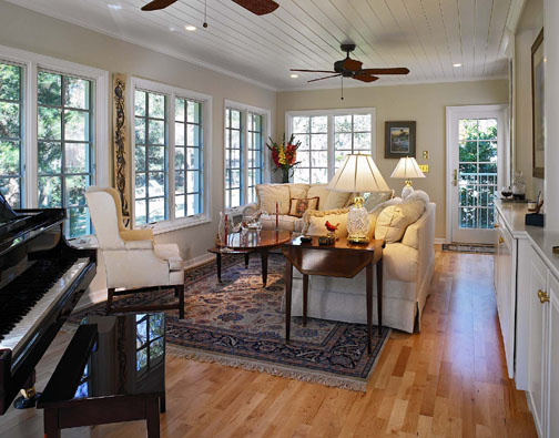 Windows surrounding three sides of the new sunroom provide an exceptional view of the professional landscaping and natural wooded area at the rear of the home. Details like the tongue-in-groove ceiling, maple floor and hand-crafted built-in bookcases lend charm to the space.
