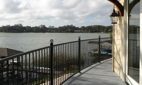 A semi-circular balcony provides a panoramic view of the pool and lake.