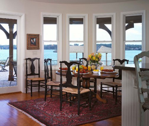 A curved wall of windows in the new breakfast area showcases an enviable view of Lake Sue.