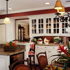 Cabinetry in the kitchen helps convey an inviting warmth that is repeated throughout the renovated space.