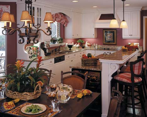 The kitchen was reconfigured to encourage friends and family to congregate. A wall between the family room and kitchen was removed as well as the kitchen's existing peninsula to create ideal traffic flow from the kitchen to the porch and pool area.