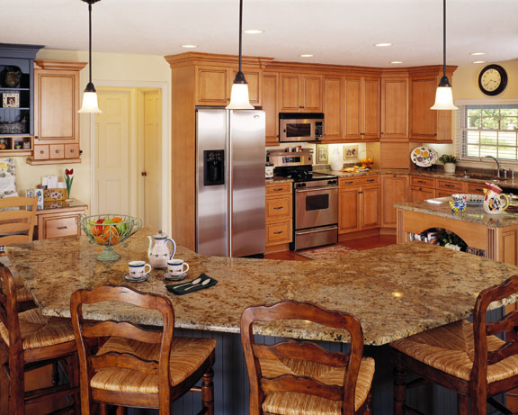Designed to function more efficiently, the hub of the kitchen is the 8 foot island with a granite countertop that combines beauty with durability for this young family. Maple cabinetry is combined with painted wood units for a casual European approach.