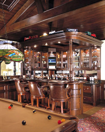 Fashioned after a Scottish pub, the room features cabinetry, tongue-and-groove ceiling and exposed wood beams all custom milled from maple wood. The wood is finished in a mahogany stain typically found in authentic pubs.