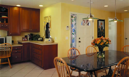 Additional space in the kitchen area allows for a convenient study area and casual dining. Not shown is the computer room, pantry, laundry room, mud room and pool bath also created in the additional space.