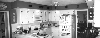 The kitchen was dated, cramped and inefficient. By gutting the kitchen, low soffits could be eliminated and the ceiling could be raised to visually expand the area.