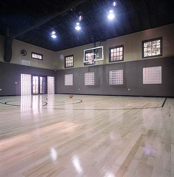 The indoor basketball half court features a NBA regulation maple floor, retractable basketball hoop, carpeted walls for soundproofing and separate air-conditioning system.