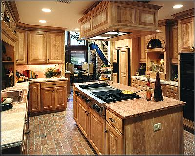 The existing kitchen space was entirely redesigned and renovated allowing traffic to flow to the new informal dining area. Solid oak cabinets, tumbled marble counter tops and a Viking brand gas stove are some of the features in the kitchen.