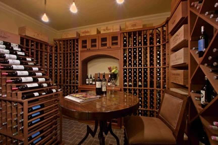 A true wine cellar is tucked away in the fully finished basement. With a 1600-bottle capacity, the wine room is conditioned for the accurate temperature, has insulated glass, a vapor-barrier system, and is finished with brick pavers.