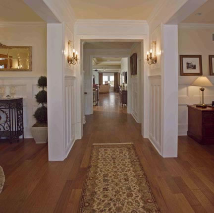 Visitors are immediately transported to a gracious bygone era when they enter the home. The foyer wainscoting is floor-to-ceiling, as well as throughout the upstairs hall. Floors are rich honey butter hickory wood, and lighting is true to the period.