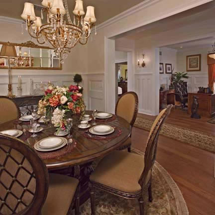 Wainscoting is carried through to the elegantly-appointed dining room. Crown moulding accentuates the contrasting hue of the ceiling.