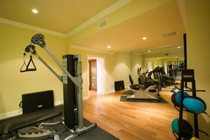 The exercise room is a spacious 27 feet x 14 feet in size. Located in the basement, it is equipped with the latest exercise equipment, wall-to-wall mirrors, and a high definition television monitor.
