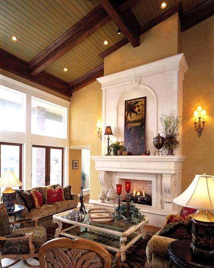 The living room features a 16 foot high stone fireplace. Floor-to-ceiling windows and French doors bring the resort-like outdoors inside.