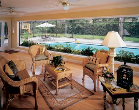 A rear wall of butt glaze windows spans the width of the extended family room, appearing to bring the pool inside. The panoramic view allows the family room to appear even larger than its newly expanded size.