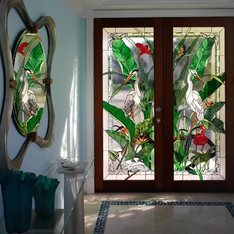 Stained glass inserts depicting the wildlife and natural beauty of Florida were supplied by the owner and installed into new front doors creating a beautiful entrance into the home.