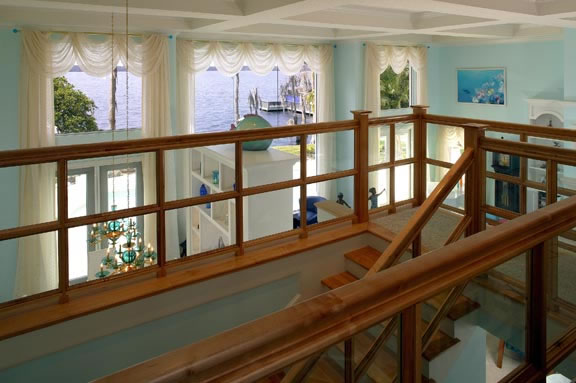The stairway, handrail and balustrade also serve a practical purpose of leading up to and defining the upstairs loft office area. As with everything else in the home, it allows for a spectacular view of the lake and Disney's nightly fireworks.